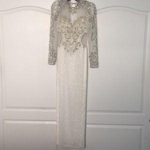 White floor length beaded column evening gown.